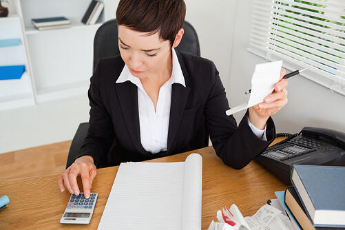 Active accountant checking receipts in her office-1