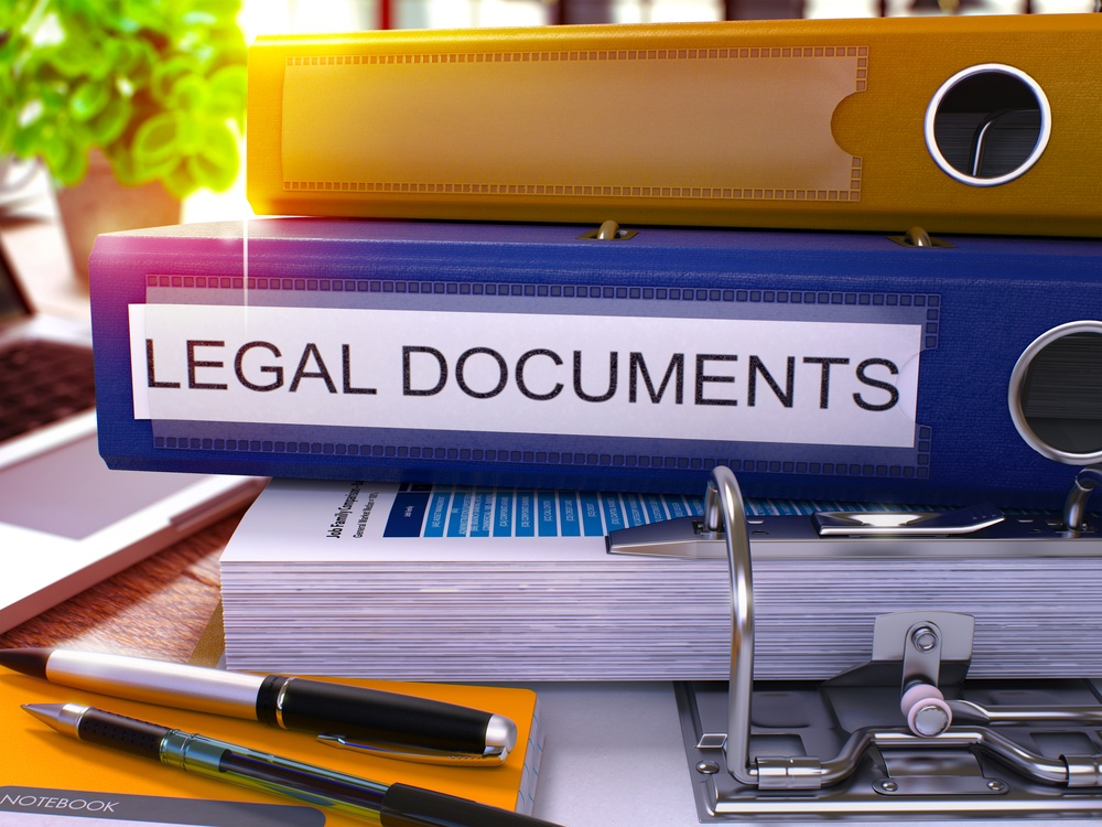 Blue Office Folder with Inscription Legal Documents on Office Desktop with Office Supplies and Modern Laptop. Legal Documents Business Concept on Blurred Background. Legal Documents - Toned Image. 3D.