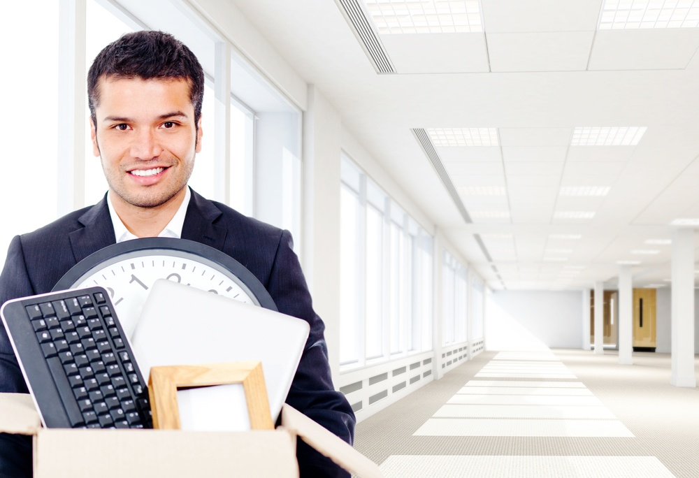 Businessman moving into a new office holding a box-1