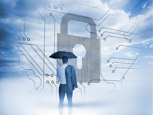 Businessman under an umbrella looking at a big padlock with circuit board and blue sky on the background.jpeg