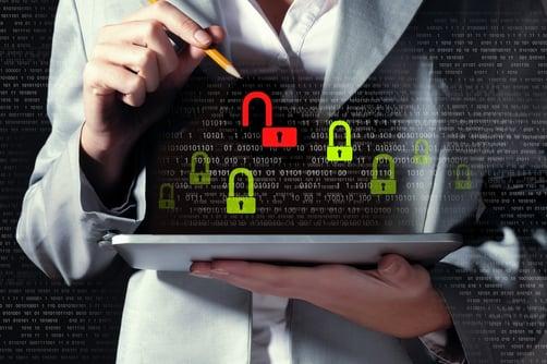 Businesswoman holding tablet pc entering password. Security concept-1.jpeg