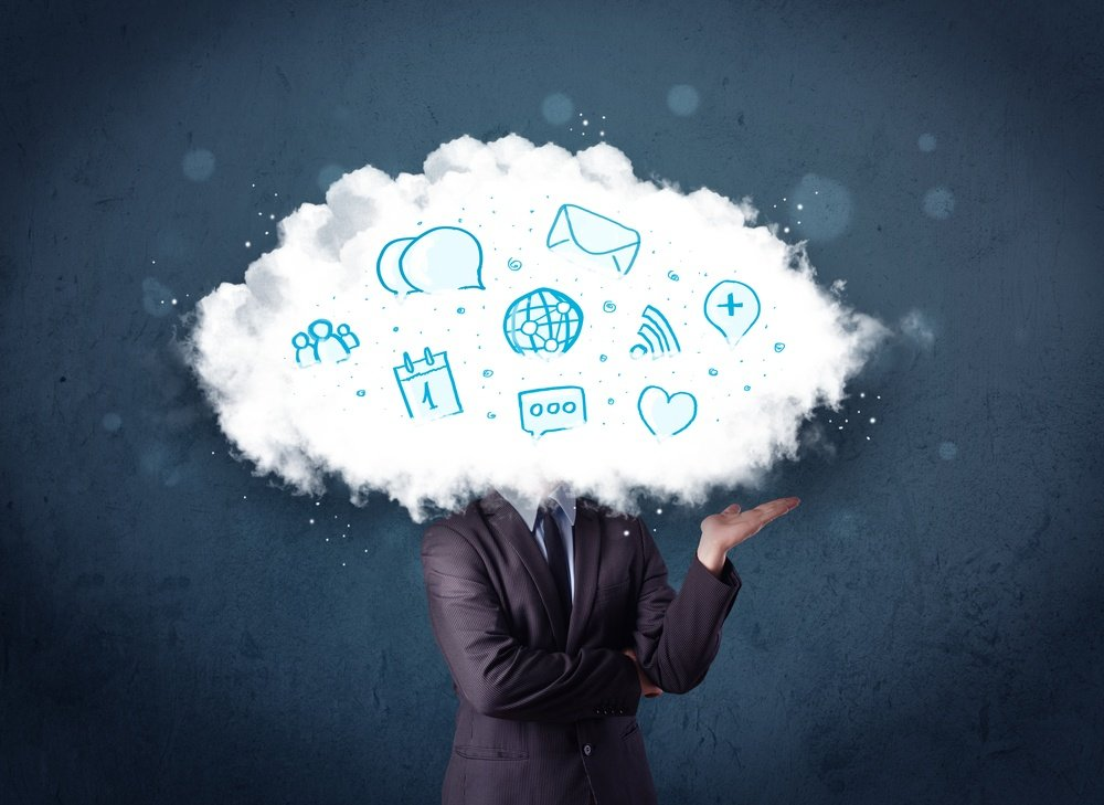 Man in suit with cloud head and blue icons on grungy background.jpeg