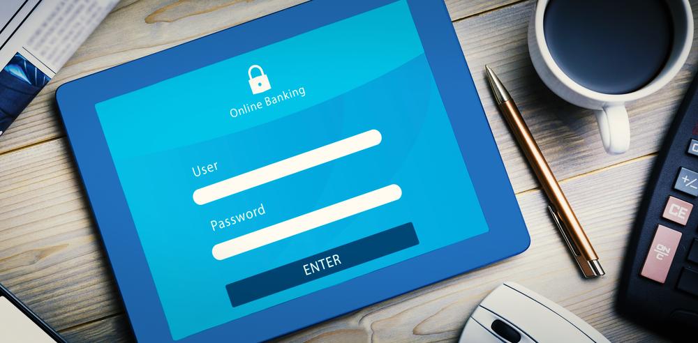 Online banking against tablet pc on desk-1