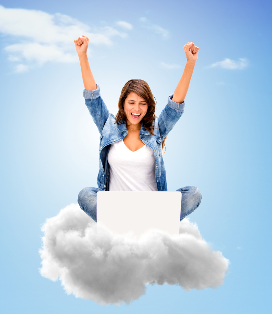 Successful woman using cloud computing with her laptop