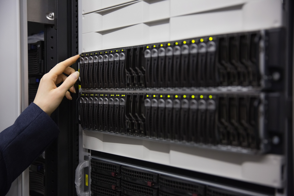 Technician working on server tower in large data center-1