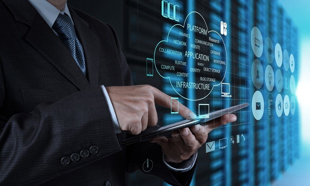 businessman hand using tablet computer and server room background