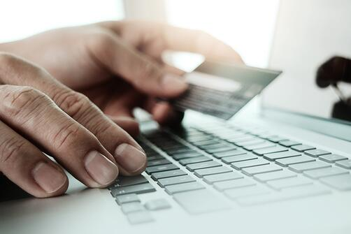 close up of hands using laptop and holding credit card  as Online shopping concept.jpeg