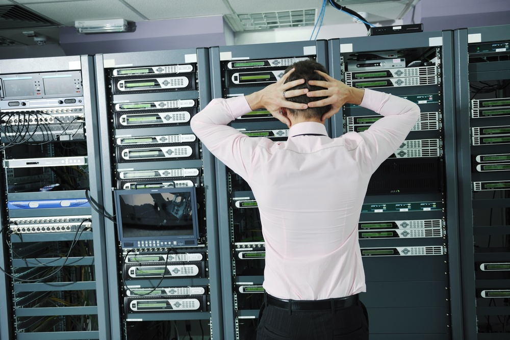 it business man in network server room have problems and looking for  disaster situation  solution-1.jpeg